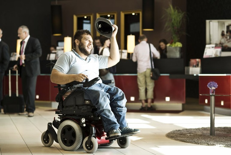 A tourist using a wheelchair in a hotel