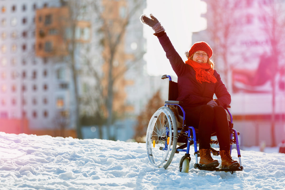 A woman using a wheelchair in the snow