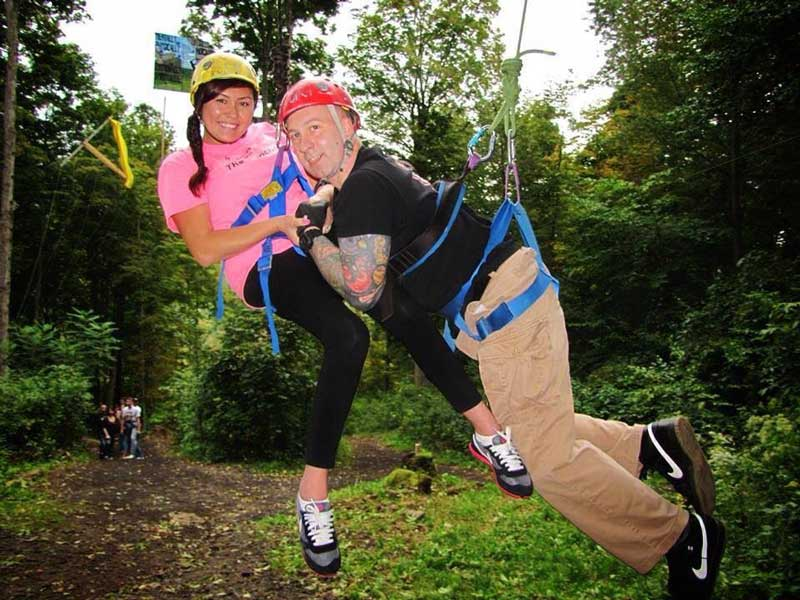 Jess zip-lining with her husband