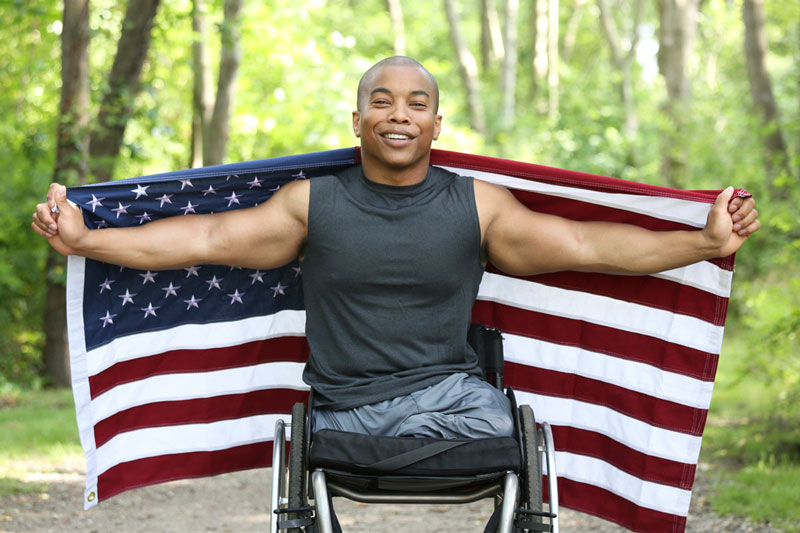U.S. military veteran with American flag