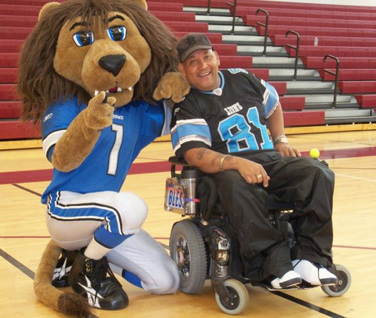 Leaping Larry with the Detroit Lions mascot, Roary