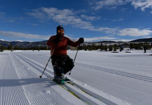 A disabled man cross-country skiing