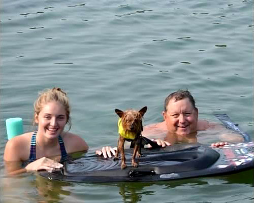 Bob swimming with his daughter