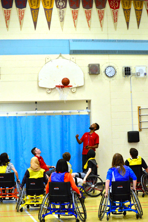School children playing wheelchair basketball