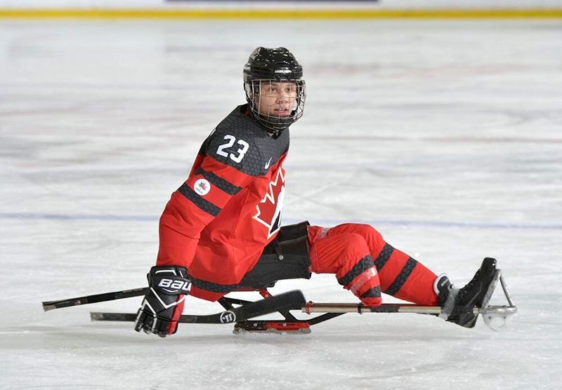 Liam Hickey playing sledge hockey