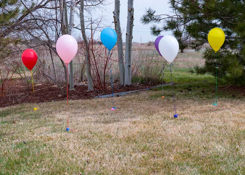 Easter eggs with balloons tied to them