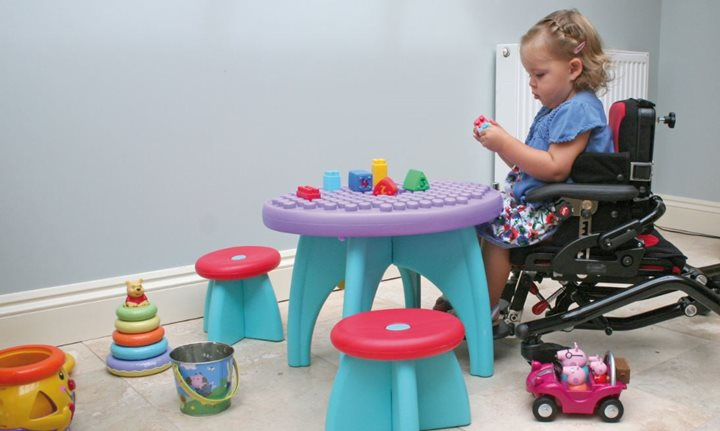 A young child with a disability playing