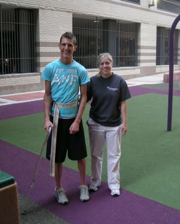 Josh walking with Brittany during physical therapy