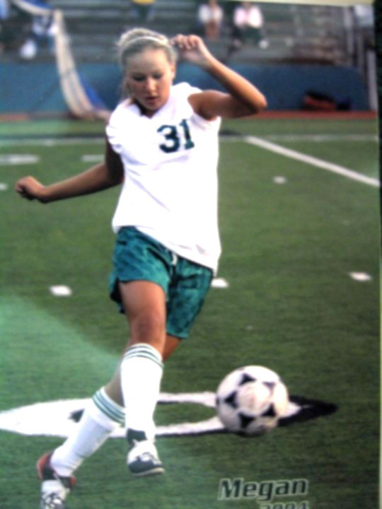 Megan in her youth playing soccer