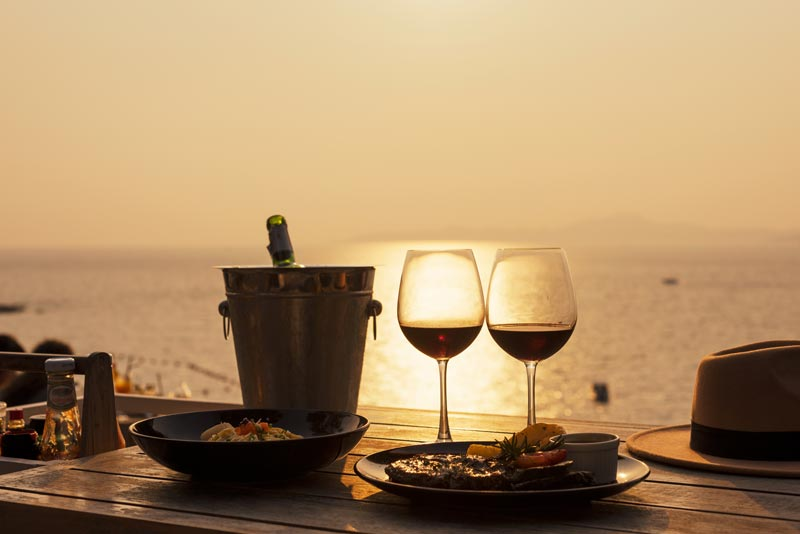 A romantic meal by the ocean sunset