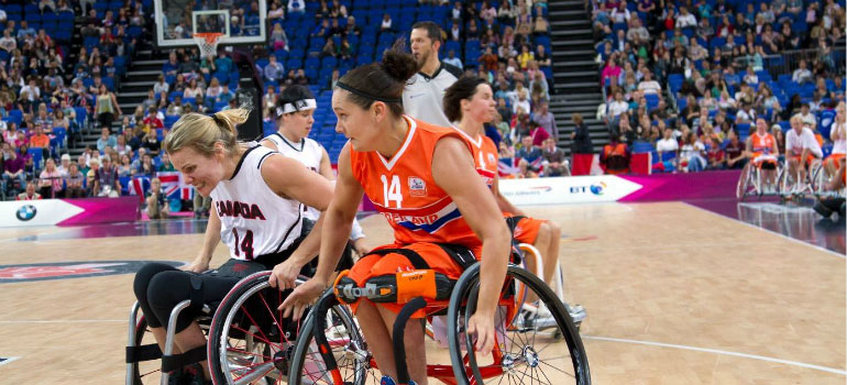 Women playing wheelchair basketball