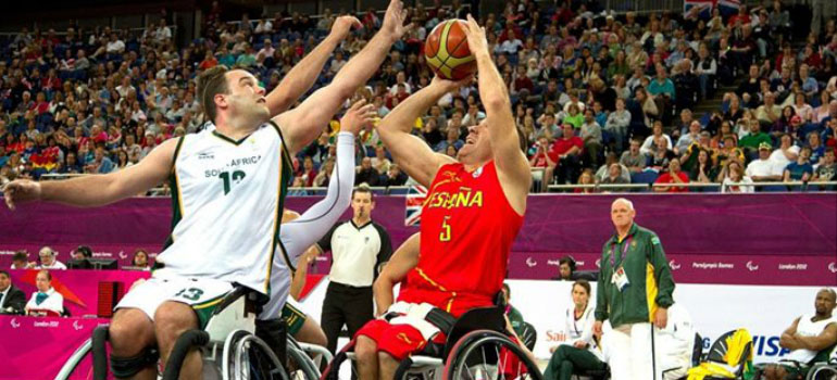 Men playing wheelchair basketball