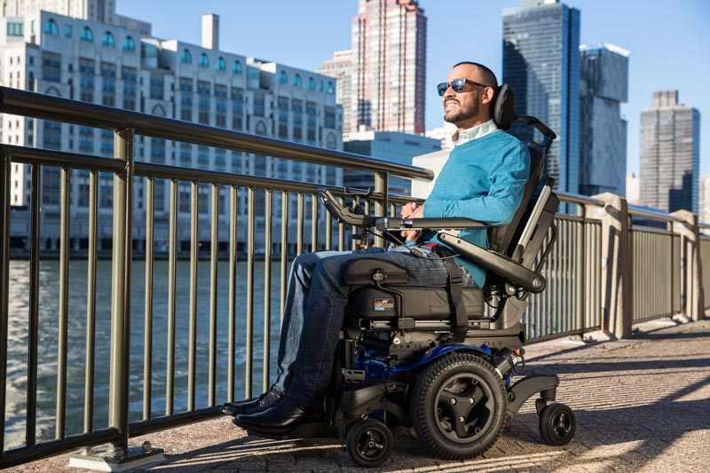 A man using a power wheelchair taking in the view