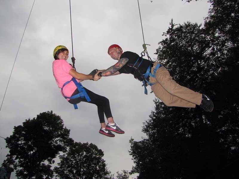 Jess on the zip-line with her husband