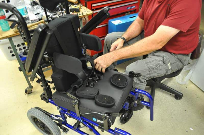 Equipment being installed on a manual wheelchair