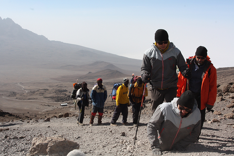 Spencer West with friends climbing Mt. Kilimanjaro