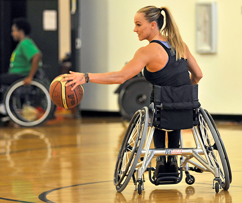 Megan Blunk playing wheelchair basketball