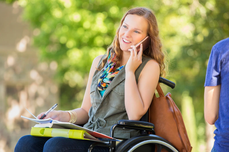 Woman in wheelchair on phone