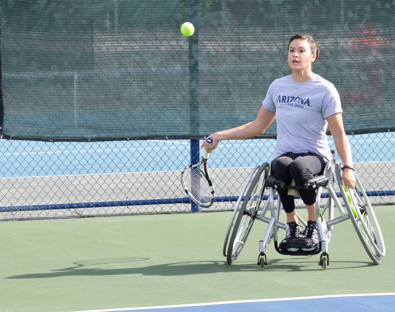 A student at the University of Arizona playing wheelchair tennis