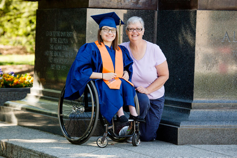 A University of Illinois graduate with her mother at the Alma Mater sculpture, a well-known icon of the university campus.
