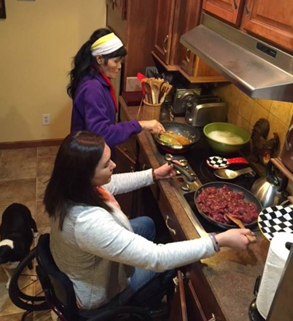 Jessica cooking with her mother in her wheelchair-accessible kitchen