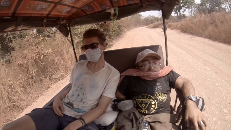 Mitch St.Pierre riding in the back of the tuk tuk in Cambodia