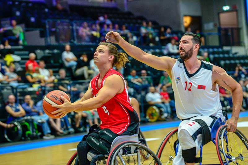 Nik competing in wheelchair basketball