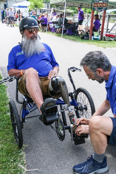 Guest gets adjustments made to his cycle before setting off down the Erie Canal.