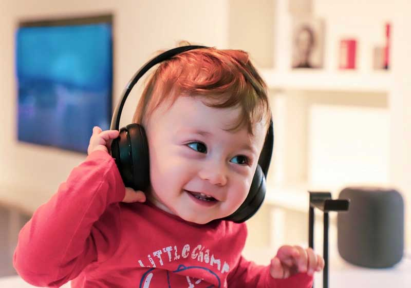 Young child wearing headphones