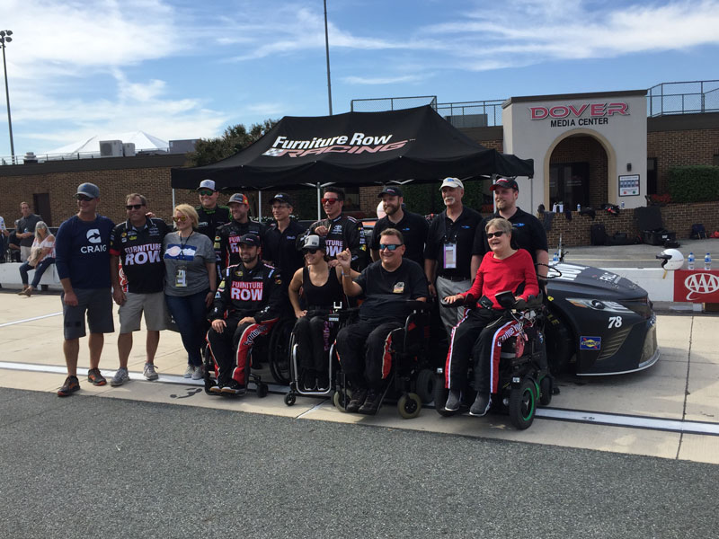 Darryl Gwynn, front row second from right, with fellow guest drivers and Furniture Row Racing team members