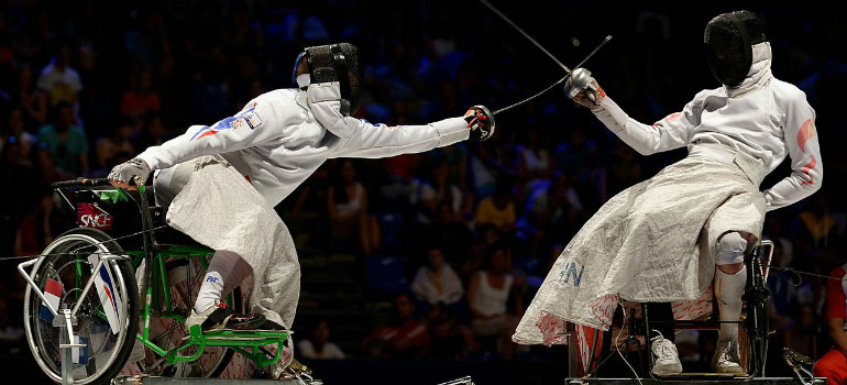 Wheelchair fencers competing