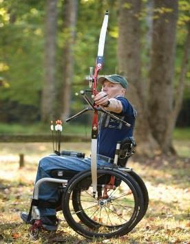 Man in wheelchair shooting a bow